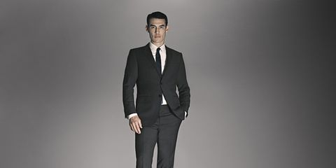 Clothing, Coat, Collar, Sleeve, Trousers, Suit trousers, Standing, Dress shirt, Suit, Formal wear,