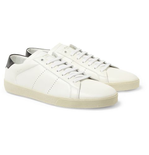 83e004ef80a Walk in these with slim chinos for an easy luxe look. SL06 leather sneakers  ($575) by Saint Laurent ...