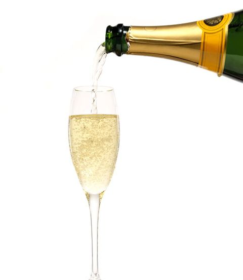 Drinkware, Yellow, Glass, Stemware, Drink, Wine glass, Barware, Alcoholic beverage, Fluid, Sparkling wine,
