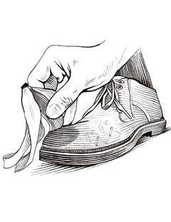man rubbing banana peel on shoe to remove scuff