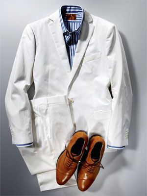 white suit with blue and white stripe shirt and leather shoes