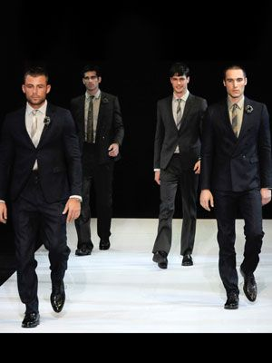 giorgio armani models in suits walking runway