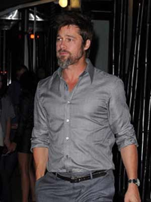 brad pitt with rolled up shirtsleeves