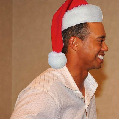 tiger woods in a santa hat for christmas