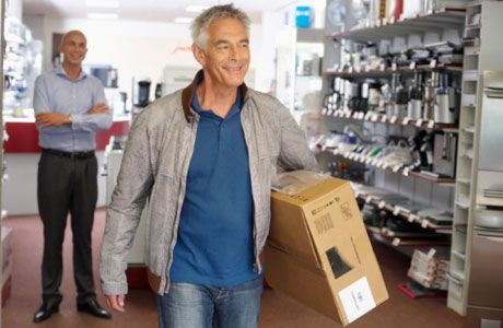 smiling man with product in box