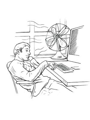 man sitting in front of fan