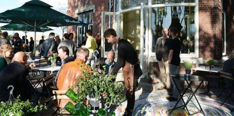 Furniture, Outdoor furniture, Flowerpot, Outdoor table, Floristry, Houseplant, Flower Arranging, Customer, Bouquet, Floral design,