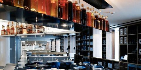 Interior design, Glass, Shelving, Dishware, Shelf, Barware, Interior design, Collection, Light fixture, Bottle,