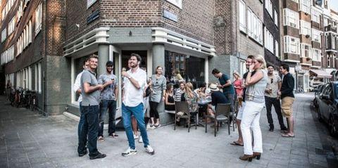 Footwear, Window, Social group, Shirt, Jeans, Photograph, Tourism, Community, Public space, T-shirt,