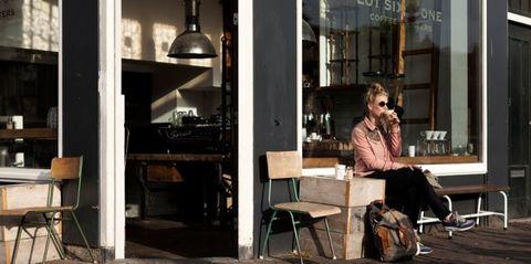 Sitting, Luggage and bags, Sunglasses, Street fashion, Backpack, Shelf, Stool,