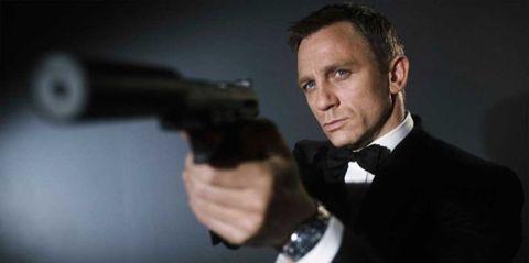 Finger, Collar, Outerwear, Formal wear, Suit, Bow tie, Shooting, Watch, White-collar worker, Air gun,