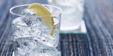 Fluid, Liquid, Lemon, Citrus, Drink, Fruit, Tableware, Glass, Meyer lemon, Distilled beverage,