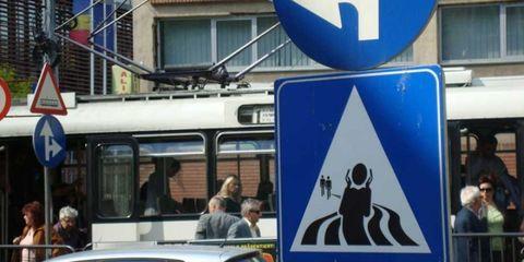 Human, Mode of transport, Transport, Passenger, Traffic sign, Sign, Signage, Glass, Travel, Public transport,