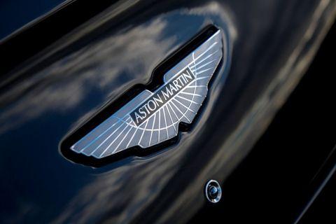 Motor vehicle, Automotive design, Symbol, Logo, Emblem, Electric blue, Trademark, Brand, Graphics,