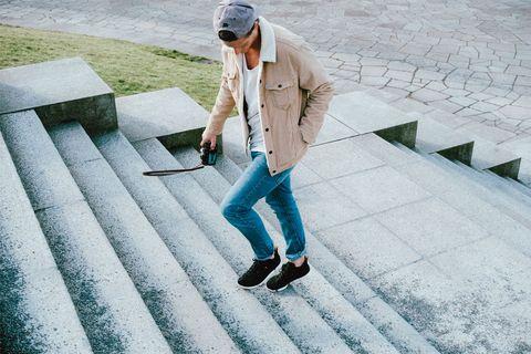 Cap, Outerwear, Human leg, Street fashion, Cool, Baseball cap, Blazer, Composite material, Snapshot, Shadow,