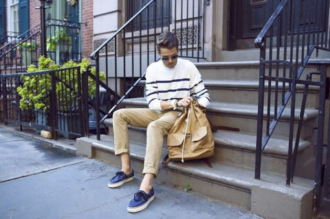 Leg, Shoe, Trousers, Sitting, Athletic shoe, Street fashion, Bag, Stairs, Sneakers, Luggage and bags,