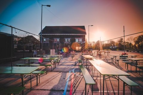 Table, Street light, Furniture, Outdoor furniture, Outdoor table, Shade, Electricity, Evening, Pole, Electrical supply,