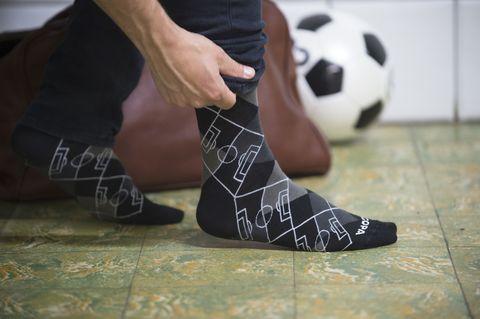 Ball, Football, Human leg, Soccer ball, Joint, Flooring, Ball, Floor, Soccer, Team sport,