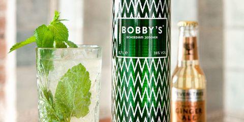 Alcoholic beverage, Green, Bottle, Drink, Liquid, Glass bottle, Drinkware, Leaf, Cocktail, Glass,