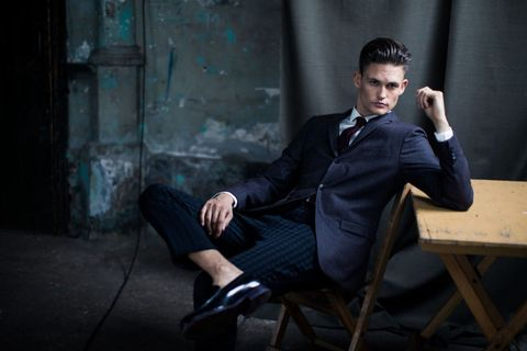 Sitting, Suit, White-collar worker, Formal wear, Photography, Flash photography, Tuxedo, Businessperson,