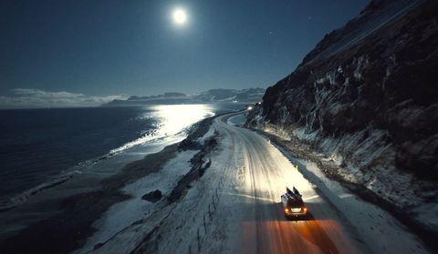 Sky, Light, Sea, Mode of transport, Road, Night, Coast, Geological phenomenon, Ocean, Horizon,