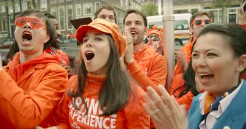 People, Orange, Product, Fan, Fun, Event, Smile, Crowd, Protest, Laugh,