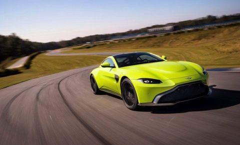 Land vehicle, Vehicle, Car, Sports car, Yellow, Automotive design, Performance car, Supercar, Coupé, Landscape,
