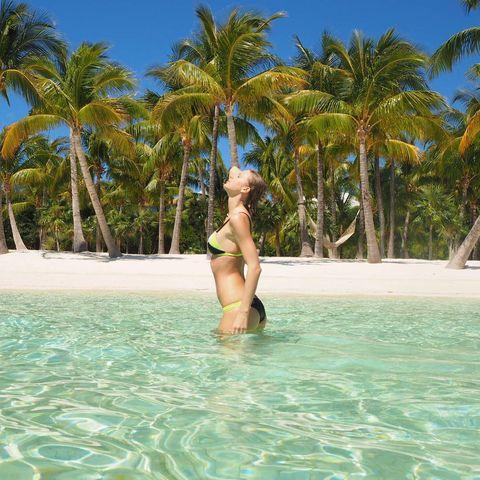 Body of water, Water, Tree, Leisure, Fluid, Arecales, Summer, Liquid, Swimwear, Aqua,