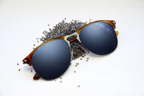 Eyewear, Vision care, Blue, Sunglasses, Brown, Goggles, Photograph, Orange, Colorfulness, Glass,