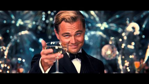 Leonardo DiCaprio drinking champagne in The Great Gatsby