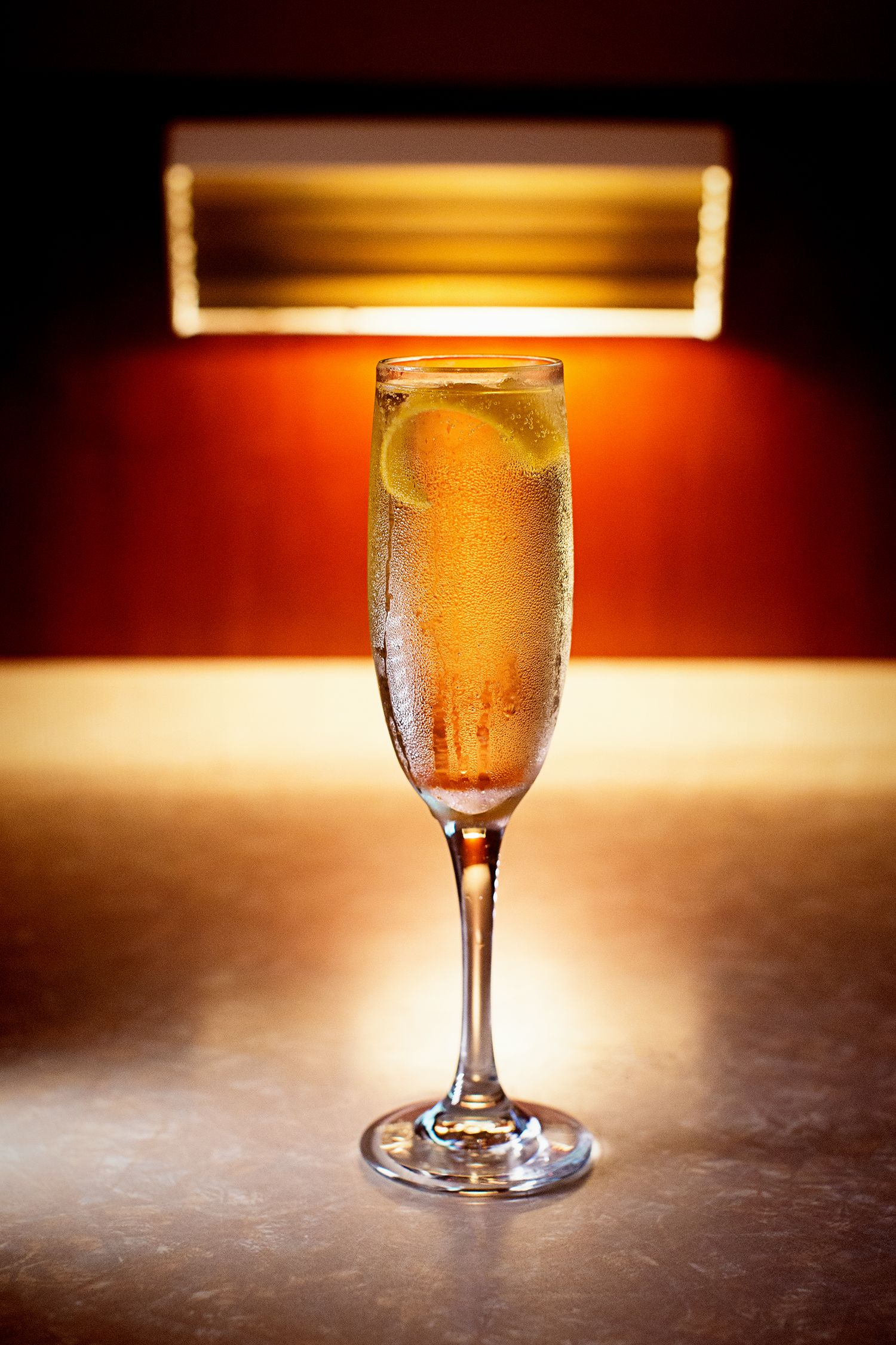 """<p>""""It's really beautiful, and perfect for an elegant party. It<br> elevates the pomp and circumstance of your traditional glass of Champagne.""""</p><p><strong>Ingredients:</strong> </p><p>• 4 oz sparkling wine</p><p>• 1 sugar cube</p><p>• Angostura bitters</p><p><strong>Directions:</strong></p><p>Soak the sugar cube in Angostura bitters and drop into a champagne flute. Fill with sparkling wine (a dry prosecco will also do). Garnish with a lemon twist.</p>"""
