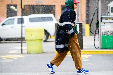Yellow, Road surface, Winter, Street fashion, Asphalt, Street, Vehicle door, Sidewalk, Snapshot, Snow,