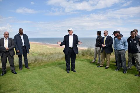 ABERDEEN, SCOTLAND - JUNE 25: US president Donald Trump visits Trump International Golf Links on June 25, 2016 in Aberdeen, Scotland. The US presidential hopeful was in Scotland for the reopening of the refurbished Open venue golf resort Trump Turnberry which has undergone an eight month refurbishment as part of an investment thought to be worth in the region of two hundred million pounds