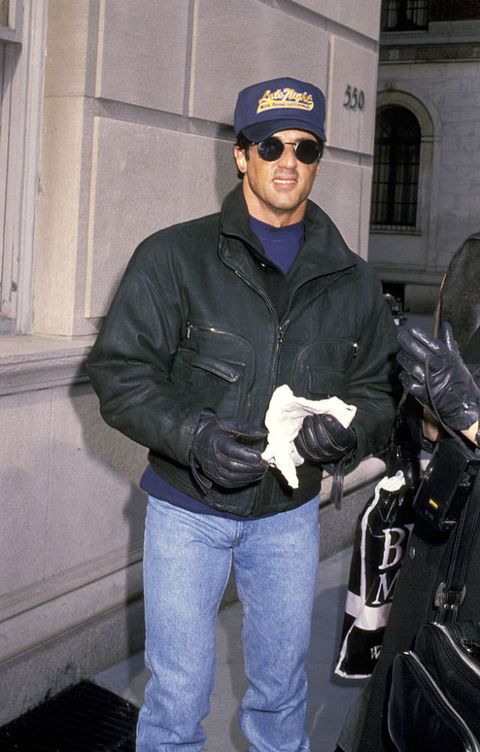 Jacket, Cap, Headgear, Outerwear, Textile, Sunglasses, Leather jacket, Eyewear, Beanie, Leather,