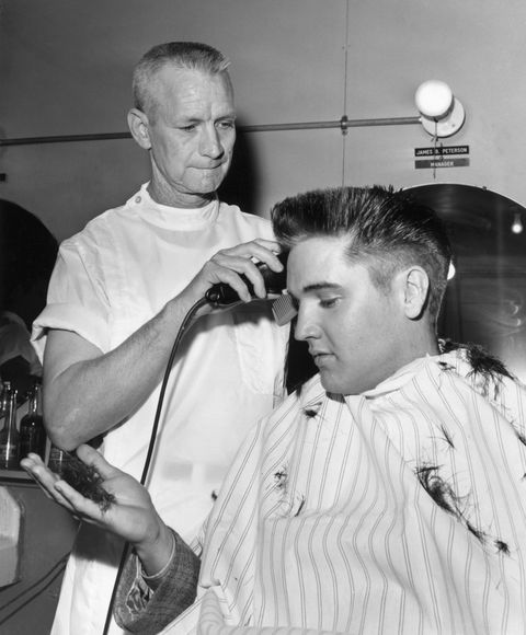Elvis getting a haircut