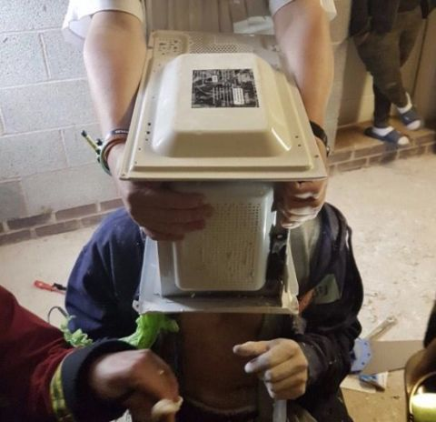 Man cements head inside microwave