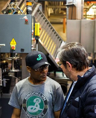 Brooklyn Brewery's Steve Hindy Chatting with an Employee.