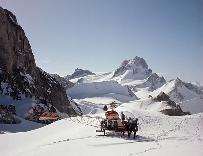 Hans Gmoser with his first heli-ski guests in 1965. Photo: CMH Heli-Skiing