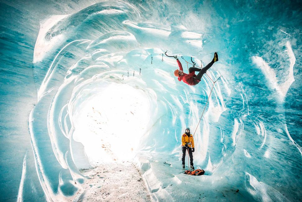 Mathis Dumas climbs steep ice deep inside Mer de Glace, Chamonix, France.
