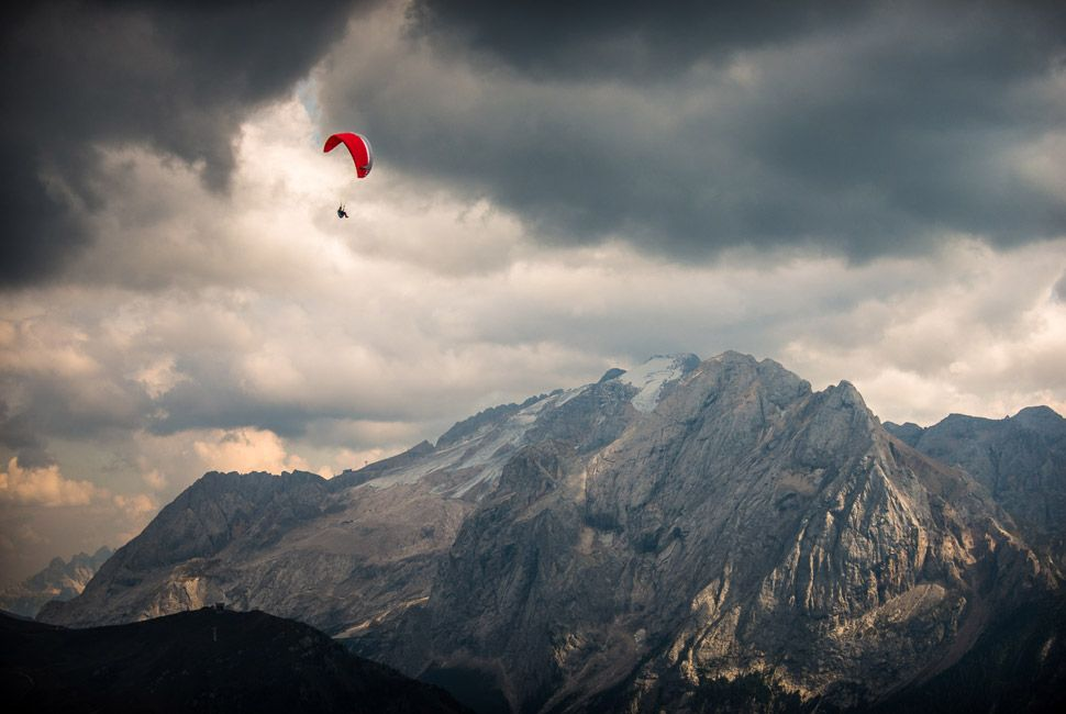 A paraglider in the sky of Val di Fassa, Trentino.