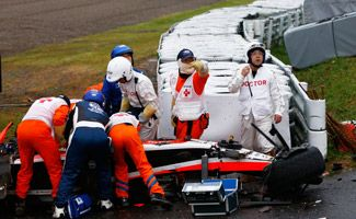 Jules Bianchi receives urgent medical treatment after crashing during the Japanese Formula One Grand Prix at Suzuka Circuit on October 5, 2014 in Suzuka, Japan.
