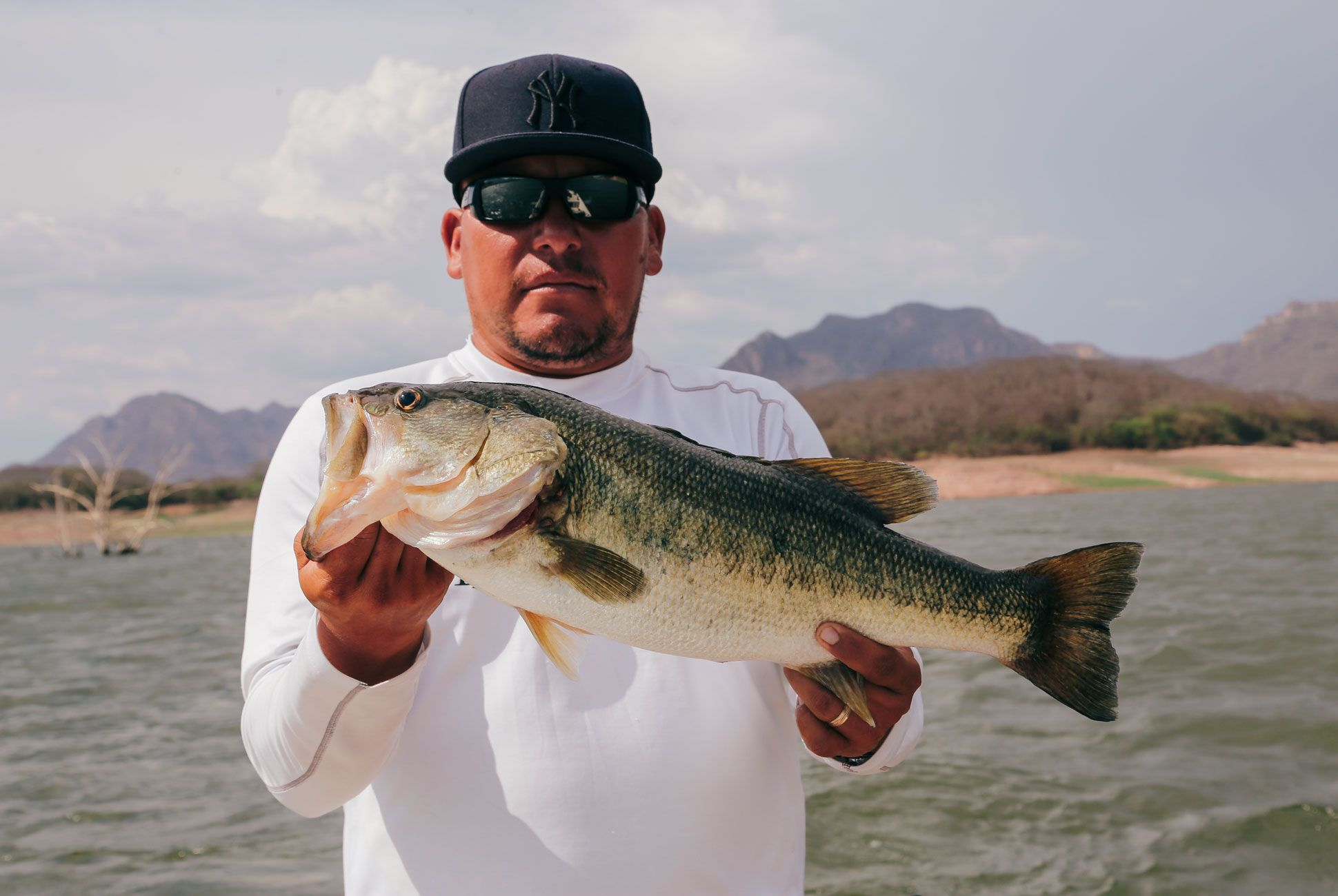 Juan, 30, makes his living as a guide on Lake El Salto. The Mexican government flooded the valley when he was just a child to create a lake for farming tilapia; when I ask him where he grew up, he pointed to the water about 50 yards from where we were casting.