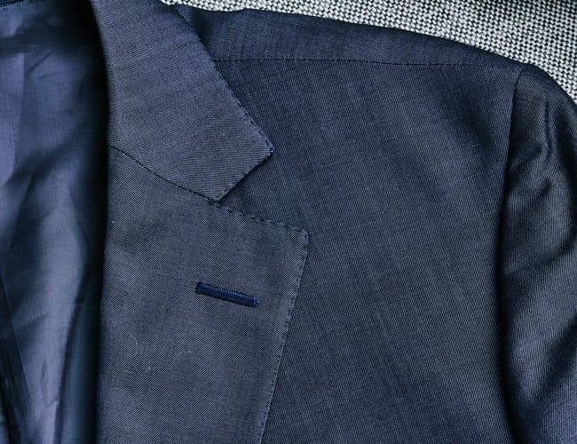 Why Do Suits Have a Random Buttonhole on the Lapel? We Found Out