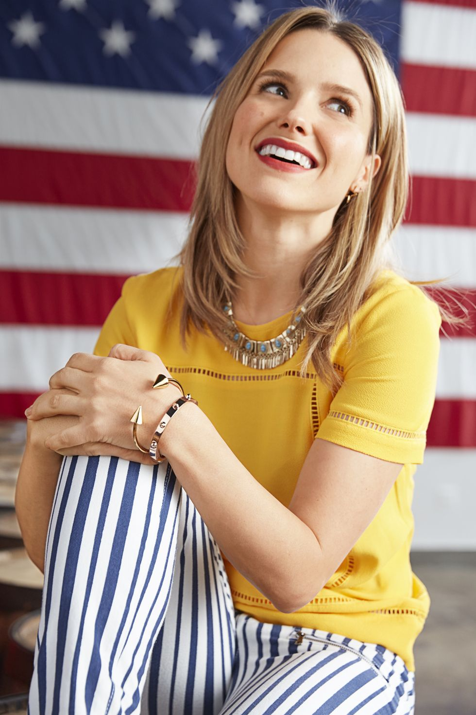 "A colorful top (with fun peekaboo trim) says a big hello to spring. Color cue: Canary yellow is the season's hottest hue.  <em><strong>Get the look:</strong></em>  • Top<strong>,</strong> Michael Michael Kors, $145, <a target=""_blank"" href=""http://www.michaelkors.com/""><em>michaelkors.com</em></a>  • Jeans, $239, <a target=""_blank"" href=""http://www.paige.com/""><em>paige.com</em></a>  • Earrings, $110, <a target=""_blank"" href=""http://www.sunaharamalibu.com/""><em>sunaharamalibu.com</em></a>  • Necklace, Jessica Simpson Collection, $58, <a target=""_blank"" href=""http://www.belk.com/""><em>belk.com</em></a>  • Bracelets, $125 and $150, <a target=""_blank"" href=""http://www.ccskye.com/""><em>ccskye.com</em></a>  ON LOCATION: <a target=""_blank"" href=""http://revbrew.com/""><em>Revolution Brewing Company</em></a>"