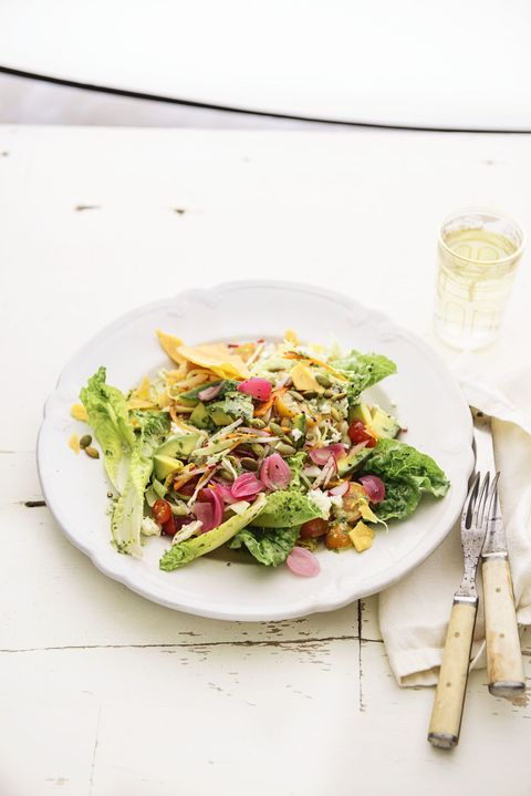 "<p>Who needs meat when you have tortilla chips, cheese, and avocado in your salad? Let's not forget about those quick-pickled onions which we guarantee you'll keep eating all week long. </p><p><a href=""http://www.goodhousekeeping.com/default/a1390/baja-salad-recipe-ghk0415/""><em>Get the recipe »</em></a></p>"