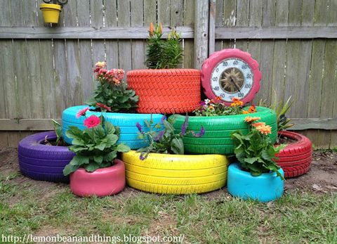 Though there's nothing very exciting about old tires, some wooden slats and a few coats of colorful spray paint can miraculously transform them into delightfully cheery backyard planters. 