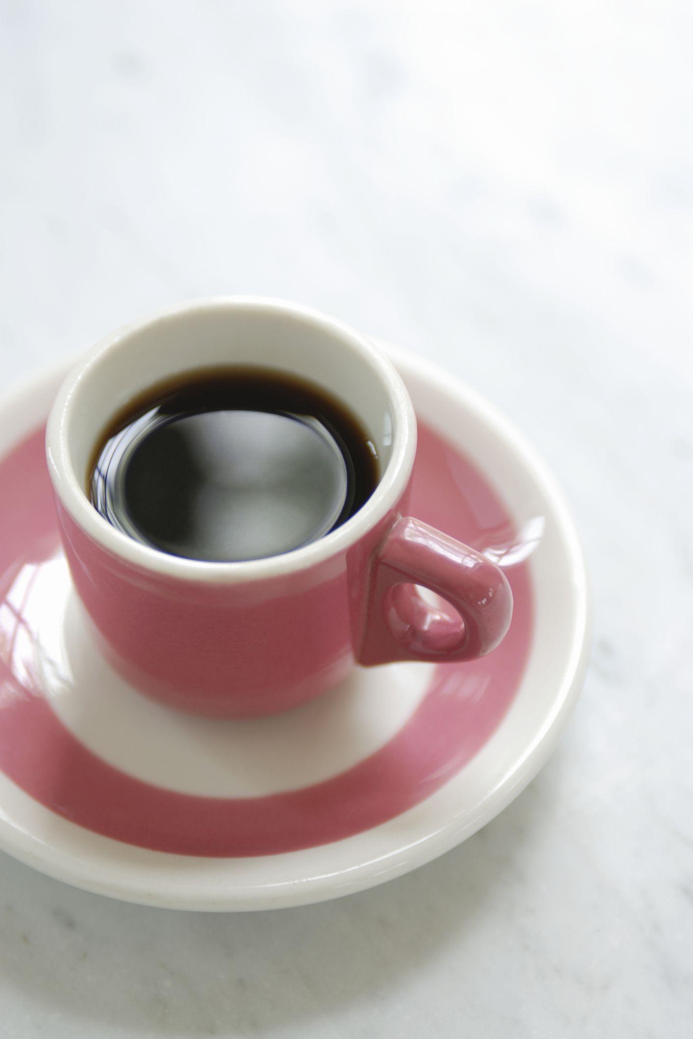 pink mug of black coffee