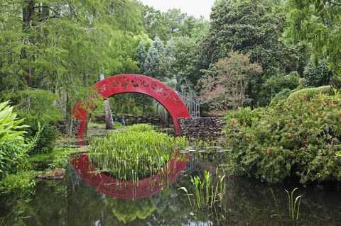 "<p>This red arched bridge at the <a target=""_blank"" href=""http://bellingrath.org/gardens-home/browse-the-estate/asian-american-gardens/"">Bellingrath Gardens and Home</a> outside of Mobile is just as pretty as the tranquil water and lush greenery it's surrounded by.</p>"