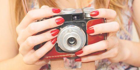 Finger, Skin, Lens, Hand, Nail, Cameras & optics, Red, Point-and-shoot camera, Digital camera, Camera lens,