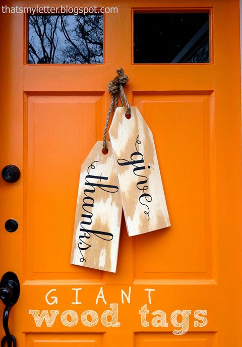 "These Thanksgiving-inspired wooden tags can be personalized with any greeting. Try ""Welcome Home"" or ""Come On In"" if you'd prefer to hang them on your door throughout the year.   <em>Get the tutorial at <a target=""_blank"" href=""http://thatsmyletter.blogspot.com/2012/11/w-is-for-wood-tags.html"">That's My Letter</a>.</em>"